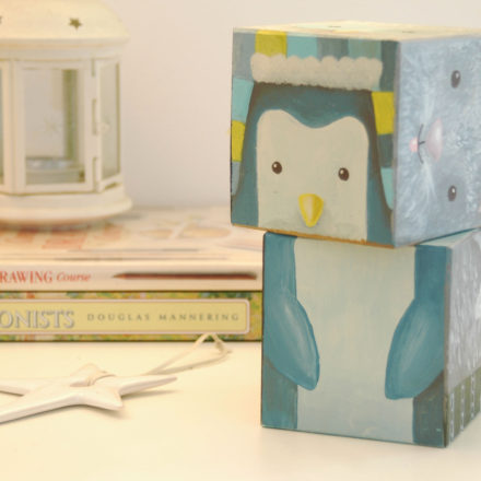 designer toy handpainted penguin on wooden cubes